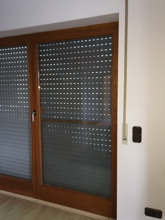 The metal shade on every German window does feature the option for pinholes of light when closed. You know, to make the place more homey. And to accent the charming pull strap to the right.